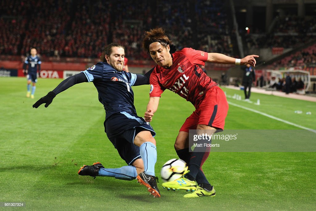 Takeshi Kanamori #14 of Kashima Antlers competes for the ball against Joshua Brillante #6 of Sydney FC during the AFC Champions League Group H match between Kashima Antlers and Sydney FC at Kashima Soccer Stadium on March 13, 2018 in Kashima, Ibaraki, Japan.