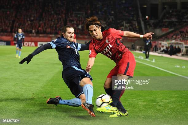 Takeshi Kanamori of Kashima Antlers competes for the ball against Joshua Brillante of Sydney FC during the AFC Champions League Group H match between...