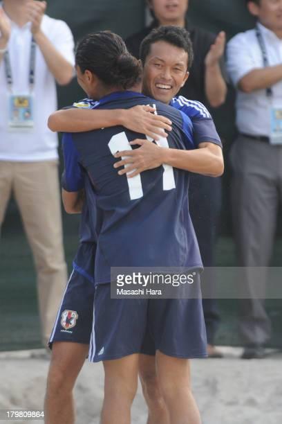 Takeshi Kawaharazuka celebrates the first goal during the beach soccer international friendly between Japan and Switzerland at Odaiba Kaihin Koen on...