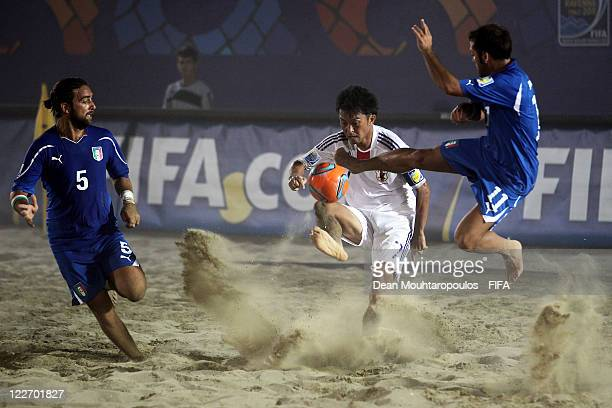 Takeshi Kawaharazuka of Japan and Paolo Palmacci and Simone Feudi of Italy in action during the preview match between Italy and Japan at the FIFA...
