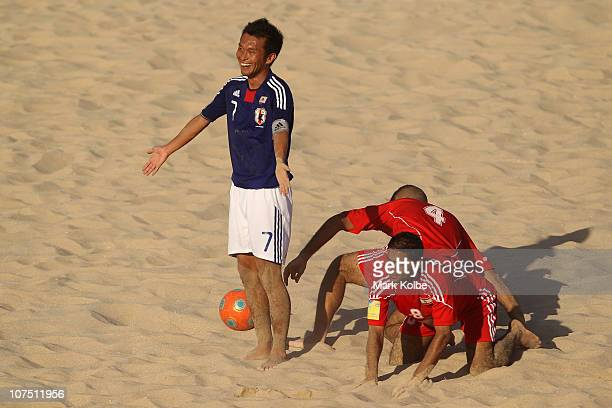 Takeshi Kawaharazuka of Japan appeals to the referee after bringing down Mohamad Merhi of Lebanon in the Men's First Round Group C Match 9 Beach...
