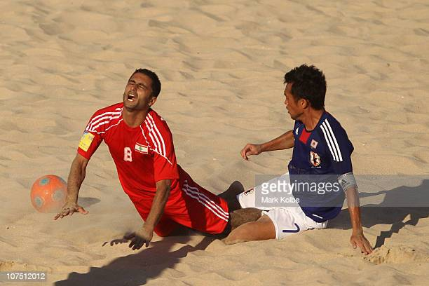Takeshi Kawaharazuka of Japan brings down Mohamad Merhi of Lebanon in the Men's First Round Group C Match 9 Beach Soccer match between Japan and...