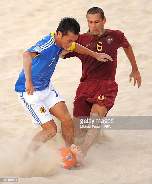 Takeshi Kawaharazuka of Japan challenges Alan of Portugal during the FIFA Beach Soccer World Cup Quarter Final match between Japan and Portugal at...
