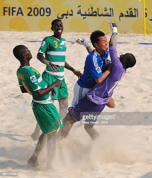 Takeshi Kawaharazuka of Japan crashes into goalkeeper Hamed Coulibaly of Ivory Coast during the Group B FIFA Beach Soccer World Cup match between...