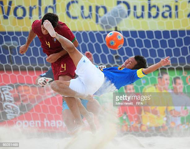 Takeshi Kawaharazuka of Japan has his shot blocked by Torres of Portugal during the FIFA Beach Soccer World Cup Quarter Final match between Japan and...