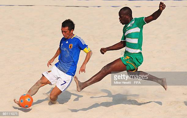 Takeshi Kawaharazuka of Japan is challenged by Abdoulaye Traore of Ivory Coast during the Group B FIFA Beach Soccer World Cup match between Japan and...