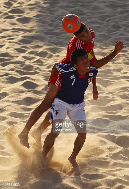 Takeshi Kawaharazuka of Japan is challenged by Hussein Al Saleh of Lebanon in the Men's First Round Group C Match 9 Beach Soccer match between Japan...