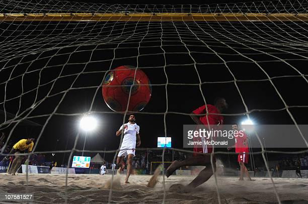 Takeshi Kawaharazuka of Oman scores a goal in the Men's Beach Soccer Quarterfinal match between Oman and Bahrain at Al-Musannah Sports City during...