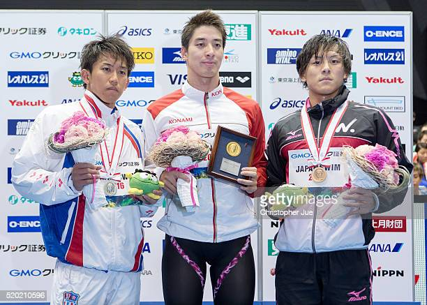 Takeshi Kawamoto Takuro Fujii and Takaya Yasue pose for photographs after the men's 100m butterfly final during the Japan Swim 2016 at Tokyo Tatsumi...