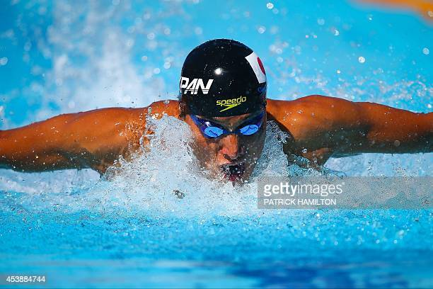 Takeshi Matsuda of Japan swims during the 200m butterfly heat at Gold Coast Aquatic Centre in Gold Coast on August 21 2014 The Pan Pac swimming...