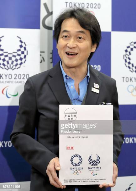 Takeshi Natsuno a member of the mascot screening committee for the 2020 Tokyo Olympics and Paralympics poses for a photo in Tokyo on Nov 20 with a...