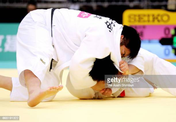 Takeshi Ojitani and Kokoro Kageura compete in the Men's 100kg during day two of the All Japan Invitational Judo Championships By Weight Category at...