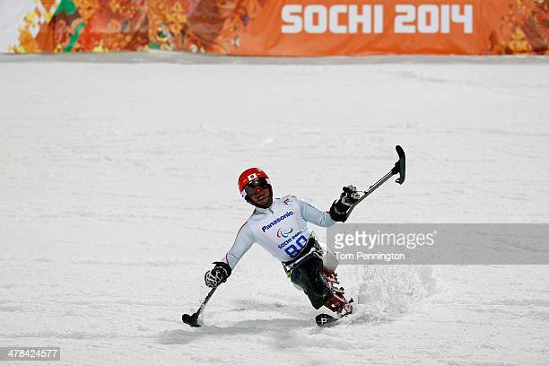 Takeshi Suzuki of Japan celebrates at the finish line in the Men's Slalom 2nd Run Sitting during day six of Sochi 2014 Paralympic Winter Games at...