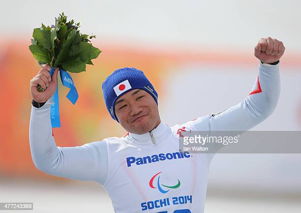Takeshi Suzuki of Japan celebrates winning Bronze after the Men's Downhill Sitting during day one of Sochi 2014 Paralympic Winter Games at Rosa...