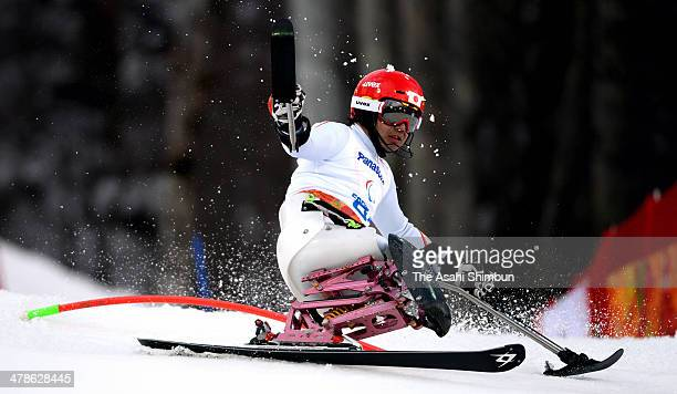 Takeshi Suzuki of Japan competes in the Men's Slalom Sitting 1st Run during day six of Sochi 2014 Paralympic Winter Games at Rosa Khutor Alpine...