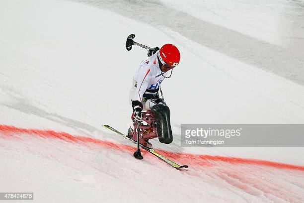 Takeshi Suzuki of Japan crosses finish line in the Men's Slalom 2nd Run Sitting during day six of Sochi 2014 Paralympic Winter Games at Rosa Khutor...