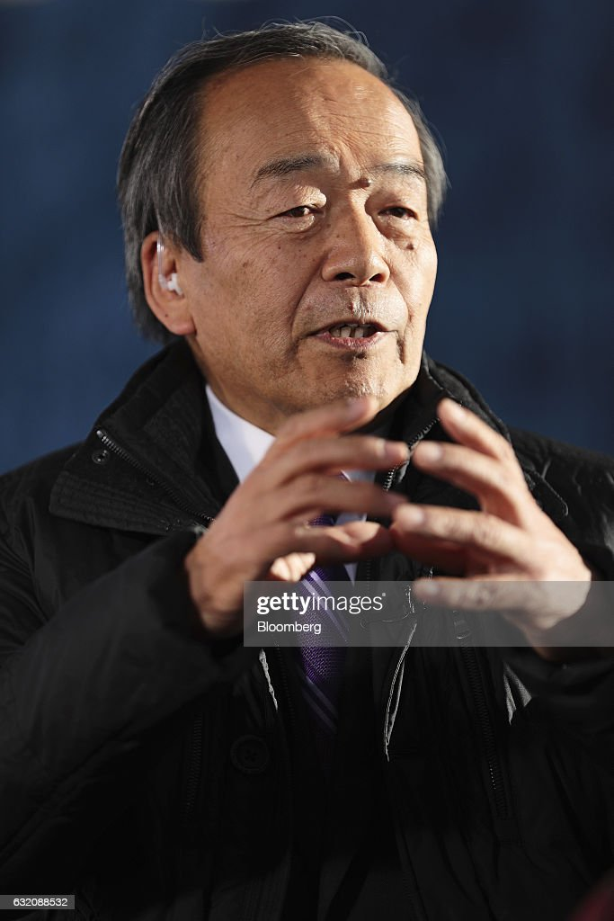 Takeshi Uchiyamada, chairman of Toyota Motor Corp., gestures as he speaks during a Bloomberg Television interview during the World Economic Forum (WEF) in Davos, Switzerland, on Wednesday, Jan. 18, 2017. World leaders, influential executives, bankers and policy makers attend the 47th annual meeting of the World Economic Forum in Davos from Jan. 17 - 20. Photographer: Simon Dawson/Bloomberg via Getty Images