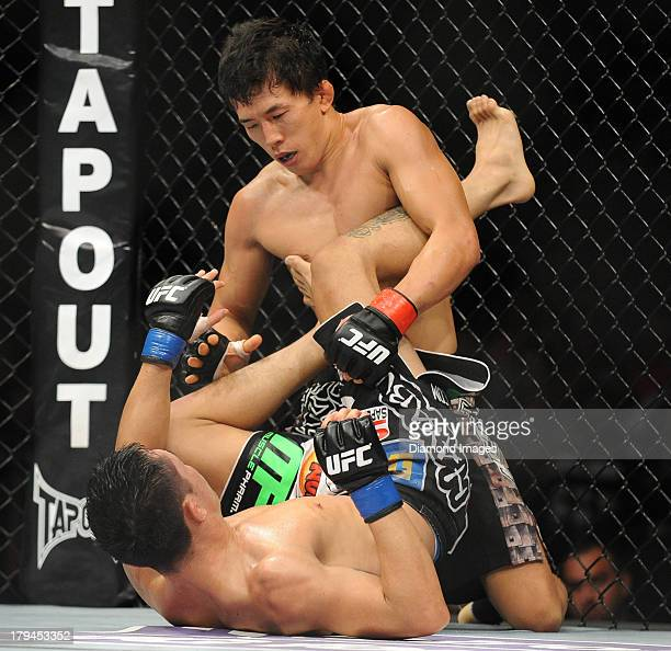 Takeya Mizugaki and Erik Perez jockey for position on the canvas during a bantamweight bout during UFC Fight Night 27 Condit v Kampmann 2 at Bankers...