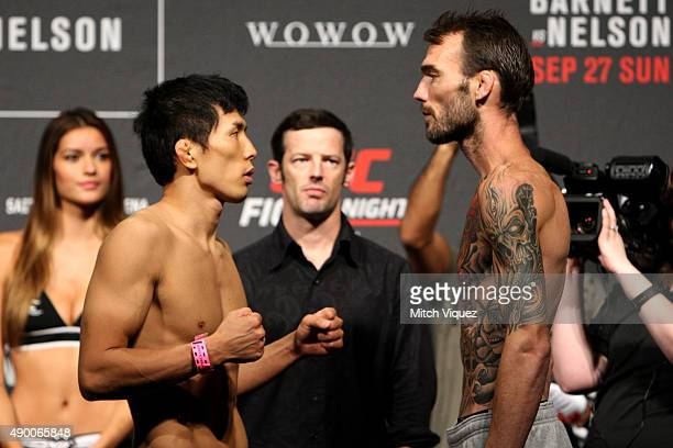 Takeya Mizugaki and George Roop during the UFC weigh-in at the Saitama Super Arena on September 25, 2015 in Saitama, Japan.
