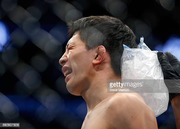 Takeya Mizugaki has ice applied to the back of his head after his first-round TKO loss to Cody Garbrandt in their bantamweight bout at the UFC 202...