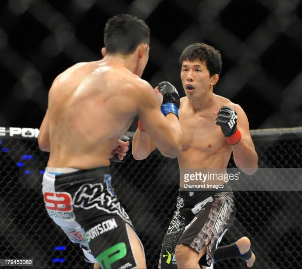 Takeya Mizugaki looks for an opening to throw a punch during a bantamweight bout during UFC Fight Night 27 Condit v Kampmann 2 at Bankers Life Field...