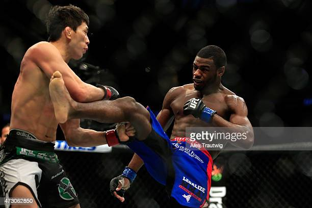 Takeya Mizugaki of Japan and Aljamain Sterling fight in their bantamweight bout during the UFC Fight Night event at Prudential Center on April 18...