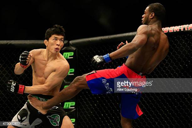 Takeya Mizugaki of Japan and Aljamain Sterling fight in their bantamweight bout during the UFC Fight Night event at Prudential Center on April 18,...
