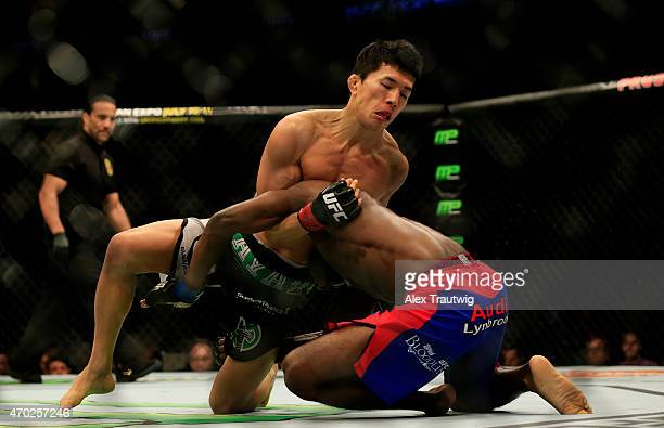 Takeya Mizugaki of Japan and Aljamain Sterling grapple in their bantamweight bout during the UFC Fight Night event at Prudential Center on April 18,...