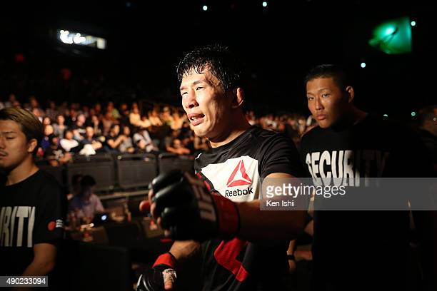 Takeya Mizugaki of Japan cries after defeating George Roop of USA during the Bantamweight bought between Mizugaki v Roop on UFC Fight Night at...