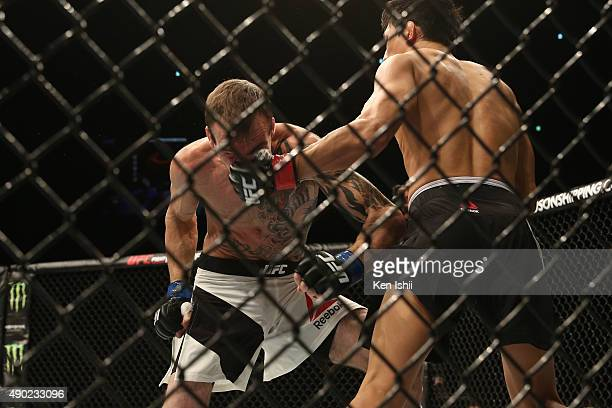 Takeya Mizugaki of Japan throws a punch against George Roop of USA during the Bantamweight bought between Mizugaki v Roop on UFC Fight Night at...