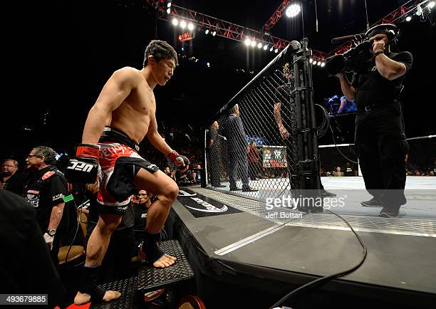 Takeya Mizugaki prepares to enter the Octagon before his bout against Francisco Rivera in their bantamweight bout during the UFC 173 event at the MGM...