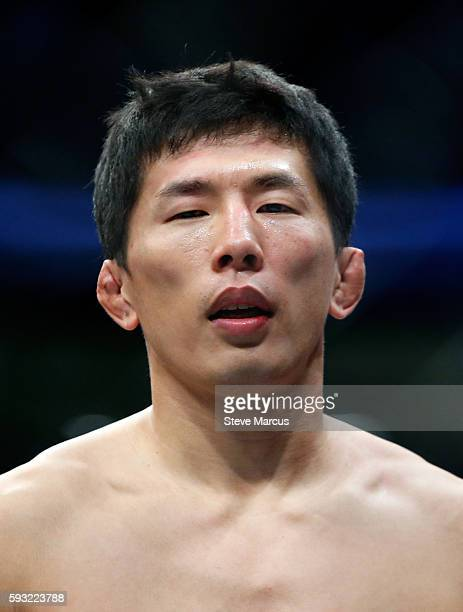 Takeya Mizugaki stands in the Octagon after his first-round TKO loss to Cody Garbrandt in their bantamweight bout at the UFC 202 event at T-Mobile...