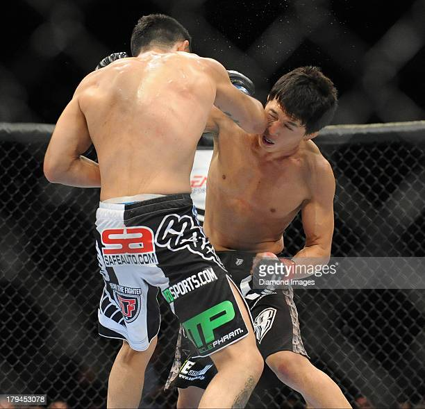 Takeya Mizugaki throws a punch during a bantamweight bout during UFC Fight Night 27 Condit v Kampmann 2 at Bankers Life Field House in Indianapolis,...