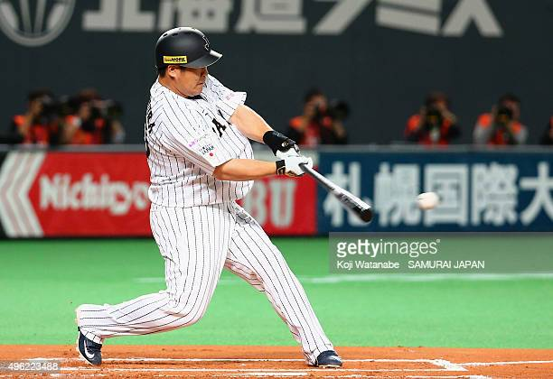 Takeya Nakamura of Japan hits a single in the bottom of first inning during the WBSC Premier 12 match between Japan and South Korea at the Sapporo...