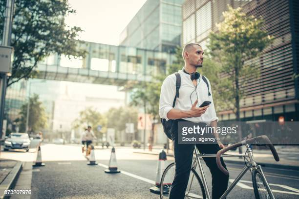 taking a bike to work - businesswear stock pictures, royalty-free photos & images