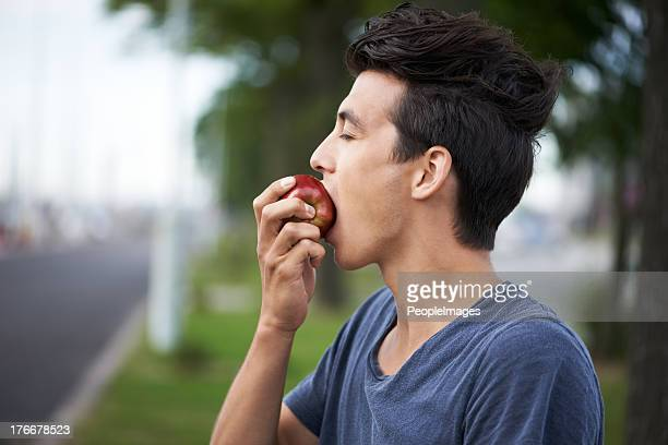 taking a bite - apple fruit stock photos and pictures