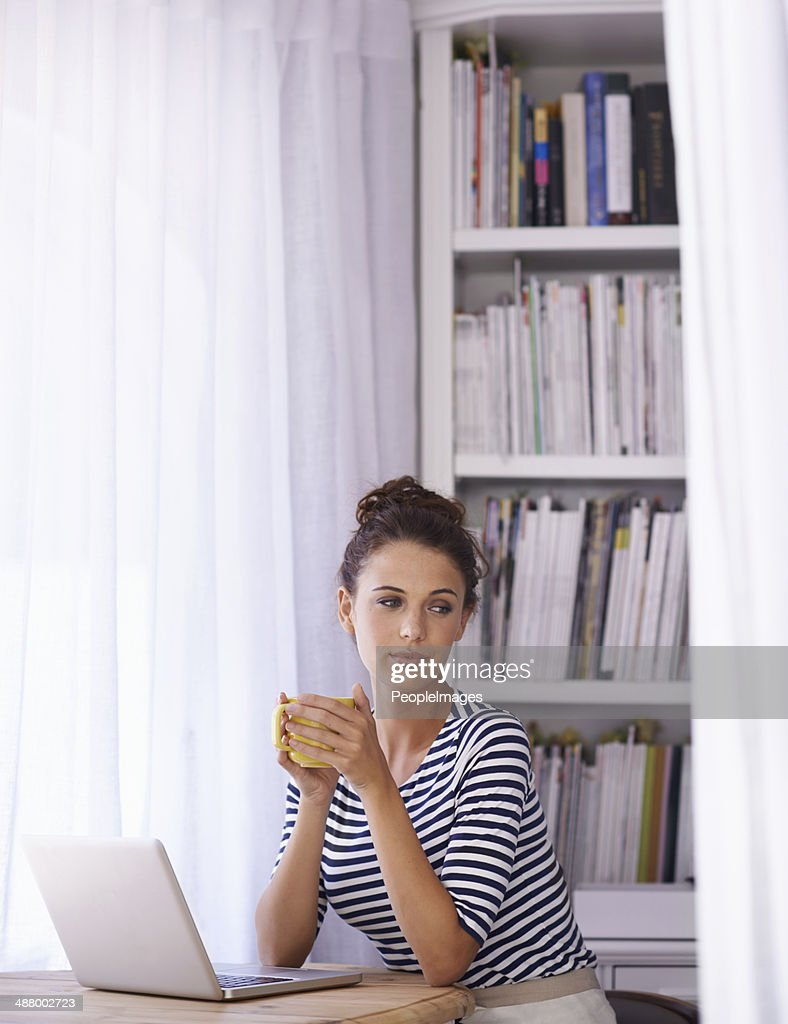 Taking a break from her blogging : Stock Photo