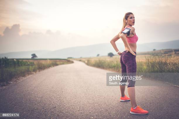taking a break from running - arms akimbo stock photos and pictures