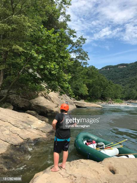 taking a break from white water rafting in the new river gorge - fayetteville stock pictures, royalty-free photos & images