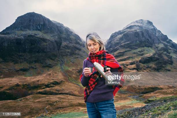 taking a break in glencoe, scotland highlands - flask stock pictures, royalty-free photos & images