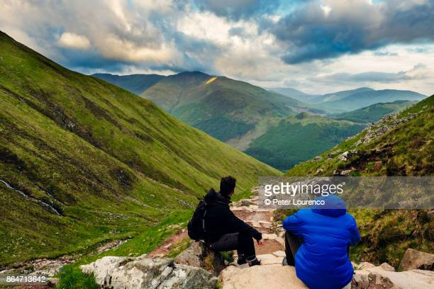 taking a break to admire the scenery - peter lourenco stock pictures, royalty-free photos & images