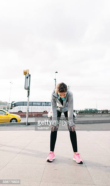 taking a breather - bend over woman stock pictures, royalty-free photos & images