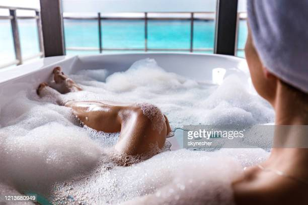 taking a bubble bath! - bubble bath stock pictures, royalty-free photos & images