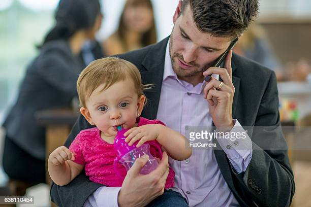 Taking a Call and Watching a His Child