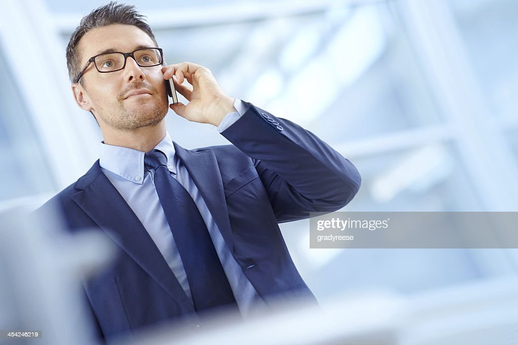 Taking a corporate call : Stock Photo