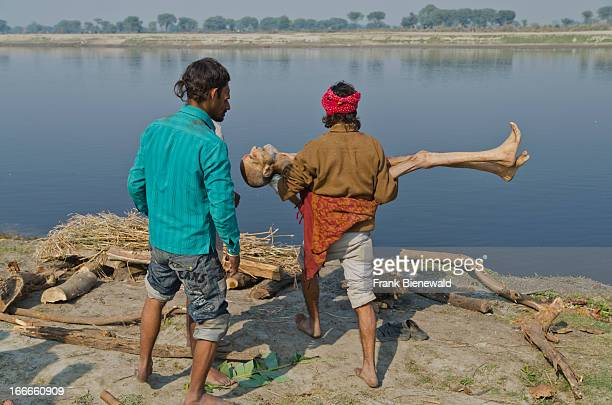 Taking a death body to the water of river Yamuna as part of a cremation ceremony..