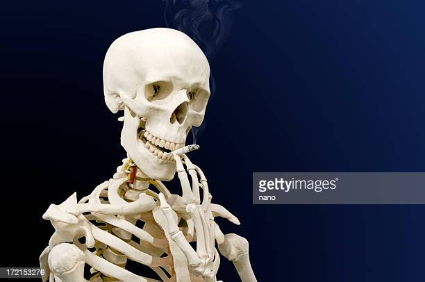 taking a drag - funny skeleton stock photos and pictures
