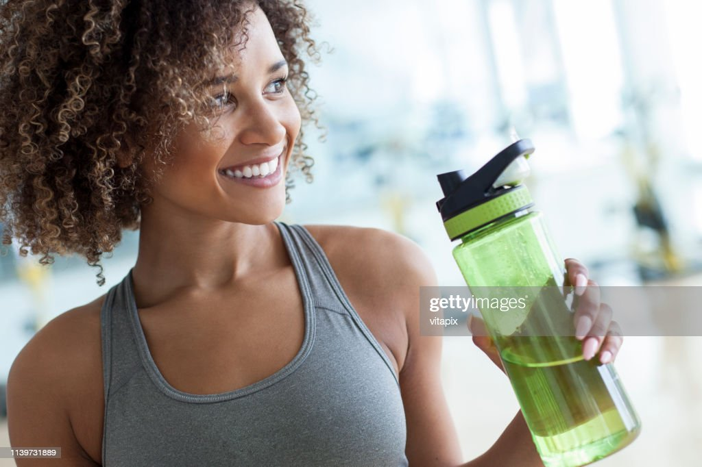Taking a Drink of Water at the Gym : Stock Photo