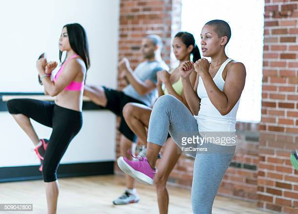 taking a kickboxing class - mixed boxing stock photos and pictures