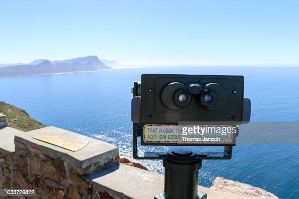 Taking a look through the telescope at Cape Point, South Africa